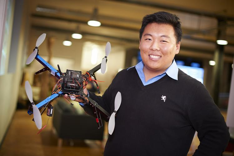 Dick Zhang, CEO of IdentifiED, holds one of the unmanned aerial robots his startup manufactures. Zhang, the youngest AlphaLab Gear inductee at 21, left his undergraduate education at the University of Pennsylvania to participate.