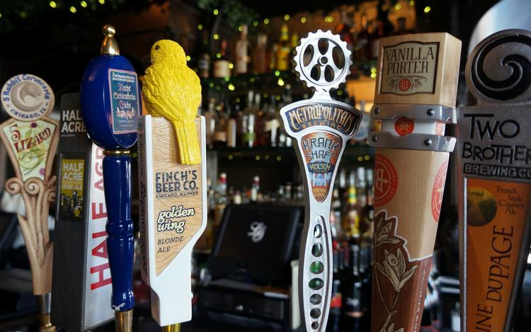 Chicago has several prominent local breweries, some of which are featured with taps at an Andersonville bar.