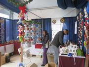Vendors set up a display in the market the day before Thanksgiving, when it opens to the public. The market will be open through Christmas Eve from 11 a.m. to 7 p.m. from Sunday to Thursday, and 11 a.m. to 8 p.m. on Fridays and Saturdays.