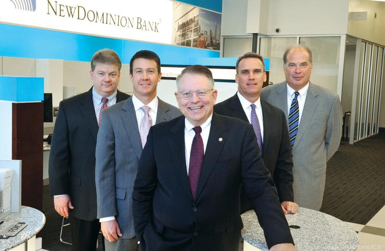John Hipp, in foreground, joined NewDominion as CEO three years ago. He recruited a team of experienced bankers to help him rebuild the bank (from left): Todd Barbee, Blaine Jackson, Marc Bogan and Greg Burke.