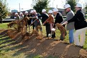 The Metropolitan Development and Housing Agency (MDHA), in partnership with Metro Arts Commission, Mayor Karl Dean, and Dowdle Construction Group, recently broke ground on Edmondson Park, located at 1642 Charlotte Avenue, across from the Oasis Center.  The park is named for Nashville native William Edmondson, a self-taught artist who was the first African American to have a solo show at New York's Metropolitan Museum of Art.    From left: Ralph Mosley, MDHA; Jim Thiltgen, MDHA; Tom Ward, Oasis Center; Erica Gilmore, Metro Council; Mayor Karl Dean, Nashville Mayor; Ronnie Steine, Council At-Large; Jennifer Cole, Metropolitan Arts Commission; Glynn Dowdle, Dowdle Construction Group; Tommy Lynch, Metro Parks; and Chase Manning, Dowdle Construction Group