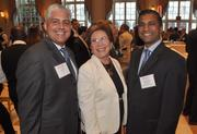 Val Perez of TD Bank, past honoree Sandy Foland of Baron Signs and Joseph D'Silva of PowerBlasters Pressure Washing.