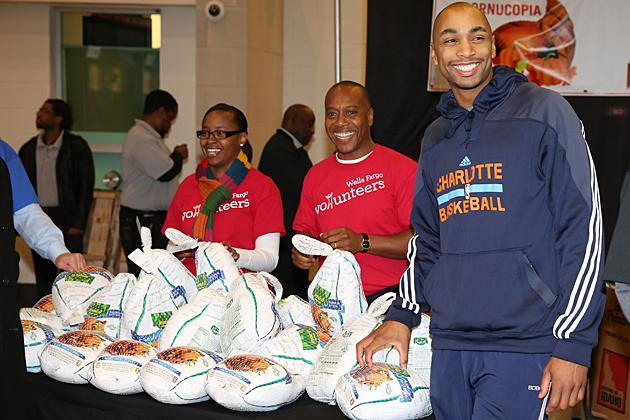 The Charlotte Bobcats, along with partners Wells Fargo, Food Lion and Coca-Cola, distributed 1,000 Thanksgiving meals to local families on Tuesday. Here, Bobcats guard Gerald Henderson smiles alongside fellow volunteers.