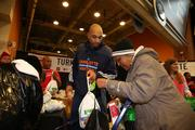 Bobcats guard Gerald Henderson bags a turkey for a local resident.