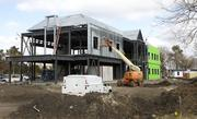 Crossland Construction Company continues to build the new CrossFirst Bank building near the corner of 13th St. and Webb Rd.