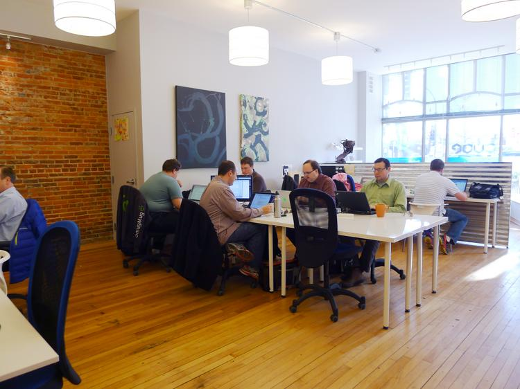 The Cube, a 600-square-foot co-working space in downtown Rochester, is owned by its members.