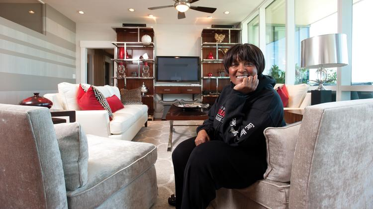 Business First is honoring Ruth W. Brinkley as the Enterprising Woman of Influence as part of our Business Women First special publication and event. She is shown here at home in her living room.