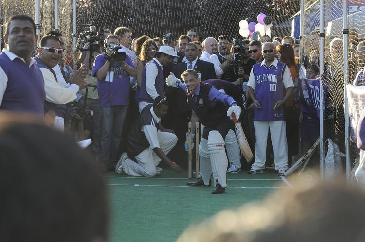 Owner Vivek Ranadive plays cricket before the Kings home opener, a sign that the team will be marketed in India, where cricket is popular.