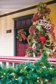 The outside Christmas tree sits on Dr. Russell's front porch.