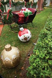 Outdoor decorations also include giant ornaments and a Santa's sleigh filled with big presents.