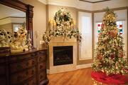 Dr. Russell's bedroom houses one of three indoor Christmas trees and her fireplace is decorated as well with holiday-themed candles, a wreath and garland.