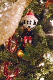 One of the Christmas trees in Dr. Stephanie Russell's home has a Disney theme. Her patients often give her Disney ornaments as gifts.