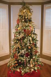 The Christmas tree in Dr. Stephanie Russell's bedroom is one of four in the house.