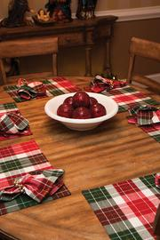 The holiday place settings are shown on the table in the breakfast room.
