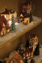 The Dickens Christmas village given to Russell by her grandmother is on display in the living room.