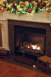 The fireplace that is the centerpiece of Dr. Stephanie Russell's living room is lined with garlands and ornaments.