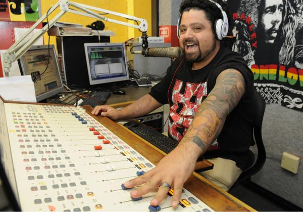 Jovan 'PhatJoe' Ladao has been a DJ for Island 98.5 for more than a decade, and he says his tattoos and hair styles have never been a concern. But for many employers, the concept of what they consider to be appropriate 'self-expression' is becoming more formal.