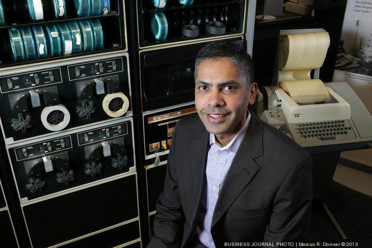 2013 CIO Award honoree Veresh Sita, global CIO of Colliers International, sits at the Living Computer Museum with a Digital Equipment Corp. PDP 8/e from the 1970s.