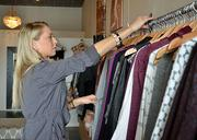 Alix Robinson organizes the clothes at the Penelope t in Jacksonville Beach on Tuesday, Nov. 19, 2013.