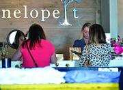 People shop at the Penelope t in Jacksonville Beach on Tuesday, Nov. 19, 2013.