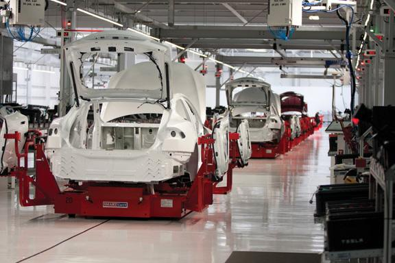 A production line of Teslas in Fremont, ready for an event marking the delivery of the first 10 Model S sedans.