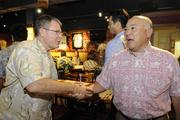 Attorney Paul Cunney, left, greets Ray Ono of First Hawaiian Bank at the Hukilau Honolulu restaurant before the Downtown Athletic Club's lunch featuring Maui native Shane Victorino of the World Series Champions Boston Red Sox.