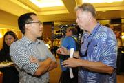 Keith Amemiya, left, of the Downtown Athletic Club talks with Bobby Curran of ESPN 1420 before a lunch featuring Maui native Shane Victorino of the World Series Champions Boston Red Sox..