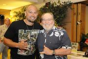 Shane Victorino of the Boston Red Sox poses for a photo with Hawaii Gov. Neil Abercrombie outside the Hukilau Honolulu restaurant.