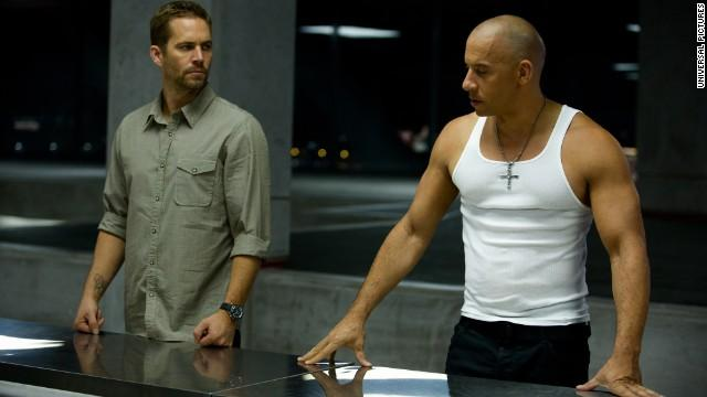 """Paul Walker (left) and Vin Diesel in a scene from """"Fast & Furious 6."""""""