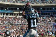 Panthers wide receiver Brandon LaFell catches a touchdown pass early in the game, vaulting the home team into the lead.