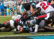 Panthers fullback Mike Tolbert stretches but can't quite find the end zone.