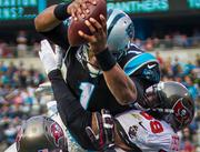Panthers quarterback Cam Newton dives over defenders for a touchdown.