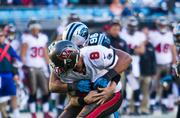 Buccaneers quarterback Mike Glennon gets sacked by defensive end Wes Horton.