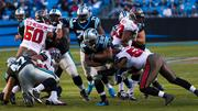 Panthers running back Jonathan Stewart protects the ball.