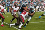 Buccaneers linebacker Jonathan Casillas puts a hard lick on running back Jonathan Stewart.