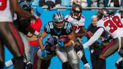 Panthers tight end Greg Olsen is surrounded by defenders after a catch.
