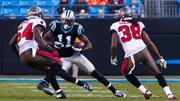 Panthers wide receiver Brandon LaFell looks for an escape route from defenders Lavonte David and Dashon Goldson.