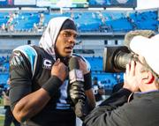 Panthers quarterback Cam Newton talks to the media after his team's eighth consecutive victory.