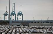 Automobiles lining up to be ship from the JAXPORT Blount Island Marine Terminal are seen on Monday, Dec. 2, 2013.