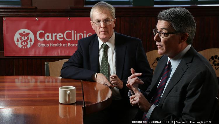 From left, George Bartell, chairman and CEO of Bartell Drugs, and Scott Armstrong, president and CEO of Group Health Cooperative, announce their companies will collaborate to create retail clinics inside Bartell Drugs locations.  The first three will open next year in Seattle's Ballard and University Village areas and at Crossroads in Bellevue.