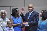 At-large council member David Howard takes the oath of office.