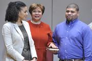 City Council at-large member Vi Lyles takes the oath of office with family members by her side.