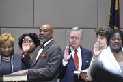Family members joined City Council representatives as they took the oath of office.