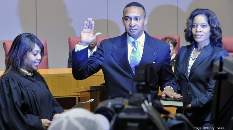 Trenna Cannon (right), the wife of former mayor Patrick Cannon, stands with her husband as he takes the oath of office in this December 2013 photo.