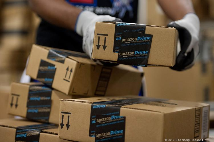 An employee stacks items to be shipped at the Amazon.com Inc. fulfillment center in Phoenix, Ariz. Many retailers, including Amazon, have extended some of the their Cyber Monday deals to Cyber Week.