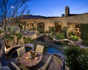 The pool and patio at night.