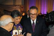 Vikings owner Zygi Wilf signs autographs for fans prior to the groundbreaking event.