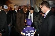 Vikings star Adrian Peterson (center) chatted with a fan on his way into the event.
