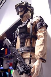 A combat simulator by Switzerland's Ruag Defense incorporates laser-equipped rifles and light sensitive targets for realistic, one-on-one combat training. This is way safer than dodge ball.