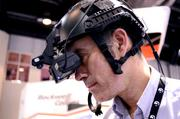 Bret Holmes tests out a helicopter gunner training system by Virtual Simulation Systems.
